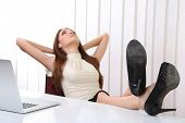 image of table manners  - Businesswoman resting at his office with her shoes on table - JPG