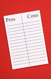 stock photo of pro-life  - A blank list of Pros an Cons on lined paper against a red textured paper background - JPG