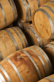 stock photo of wine cellar  - Multiple wine barrels stored in a wine cellar - JPG