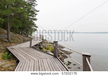 Rocky Lakeshore With Wooden Pathway