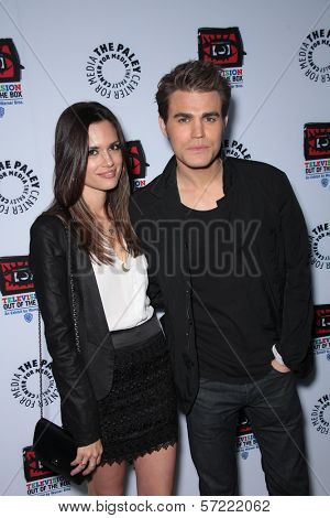 Paul Wesley and Torrey DeVitto at the opening of