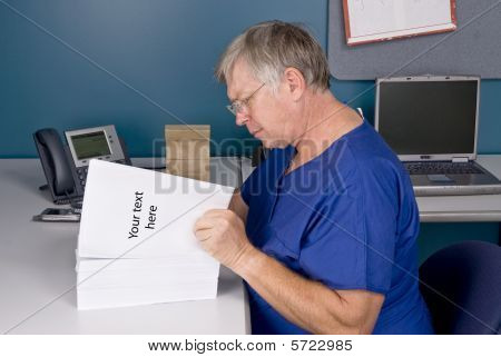 Doctor Reviewing Document