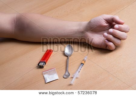 Close Up Of Addict's Hand On The Table With Drugs
