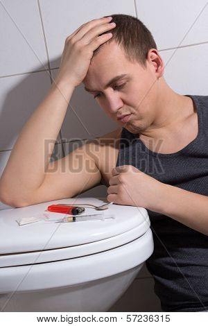 Depressed Man With Heroin Addiction In Bathroom
