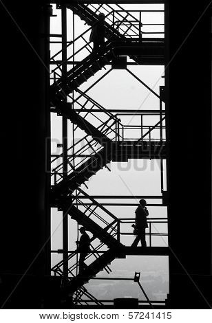 Workpeople Silhouettes At The Industrial Project