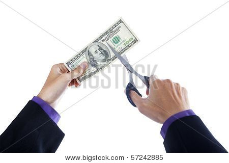 Hands With Scissors Cutting Money