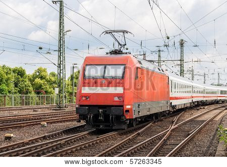 Electric Locomotive With Passenger Train On Cologne Station, Germany