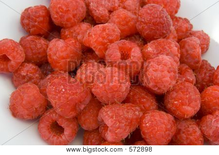 Raspberries In White Bowl