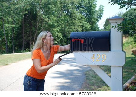 Lovely Blond Woman Looking in Mail box