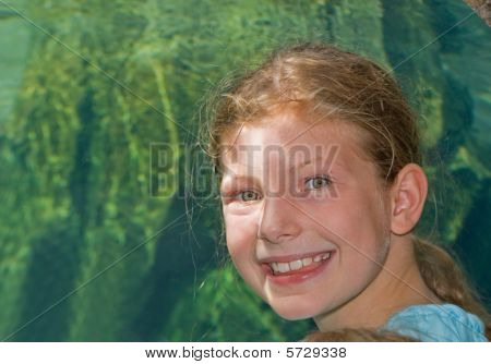 Pretty Girl With Aquarium Background