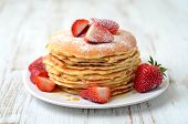 stock photo of strawberry  - stack of freshly prepared traditional pancakes with strawberries - JPG