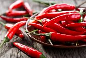picture of peppers  - red and green chili pepper on a wooden table - JPG
