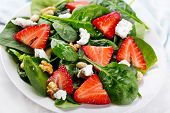 stock photo of gourmet food  - salad with strawberry spinach leaves and feta cheese - JPG
