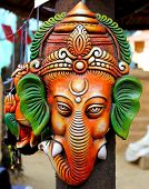 pic of laddu  - colorful lord ganesha sculpting hanging on pole - JPG