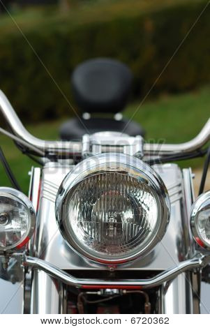 Front Light Closeup Of A Motorcycle