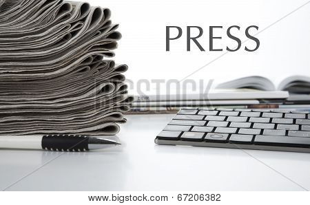 Stack Of Newspapers And Keyboard