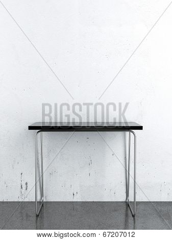 Black Table In Front Of A White Wall