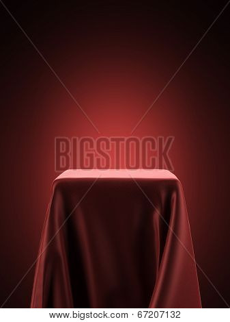 Pedestal Covered With Red Cloth