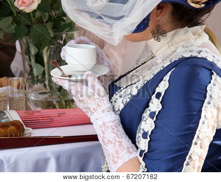 Beautiful vintage woman with cup of tea
