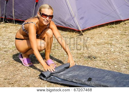 Girl Collects Or Establishes Tent