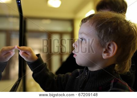 Boy Using Touch Screen