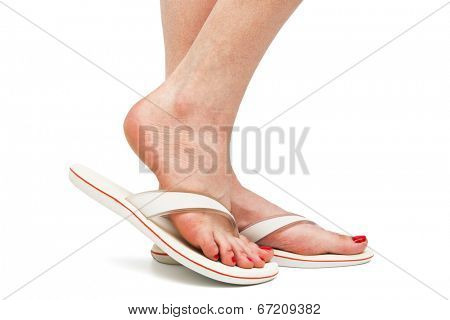 female foot in sandal on a white background