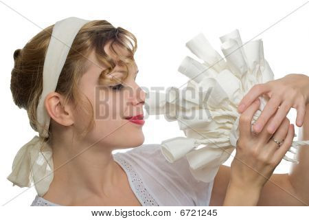 Beautiful Blonde Girl Smelling At A Bouquet Of White Paper Roses
