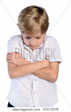 Upset Young Boy With Crossed Arms