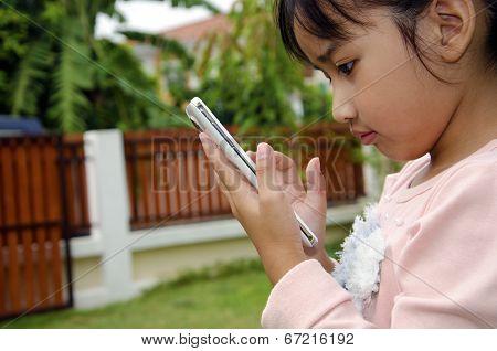 Kids playing phone