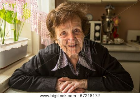 Portrait of the smiling elderly woman.