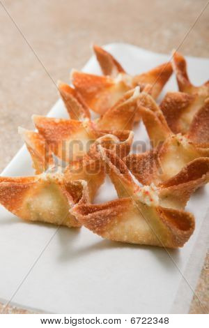 Crab Rangoons On White Paper
