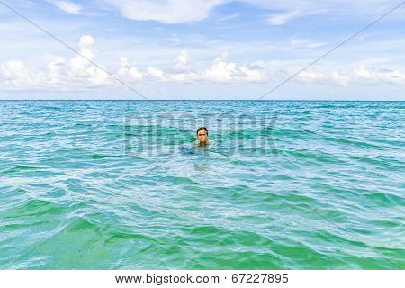 Teenage Boy Enjoys Swimming In The Ocean