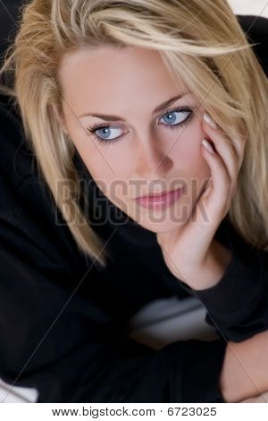 Beautiful But Sad Young Blond Woman With Blue Eyes