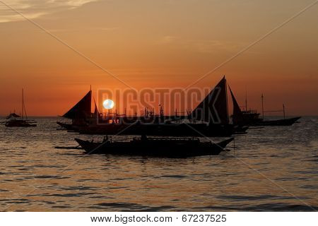 Sailing boats sea sunset