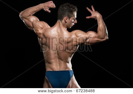 Serious Men Standing And Flexing Muscles