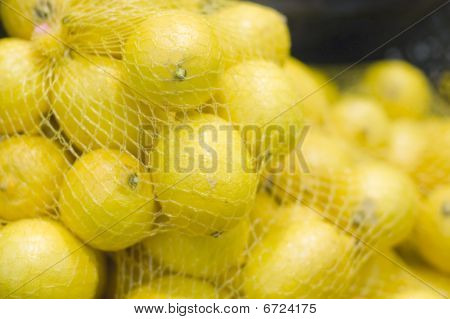 Packages With Lemons In A Supermarket