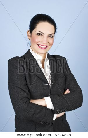 Happy Executive Woman With Arms Folded