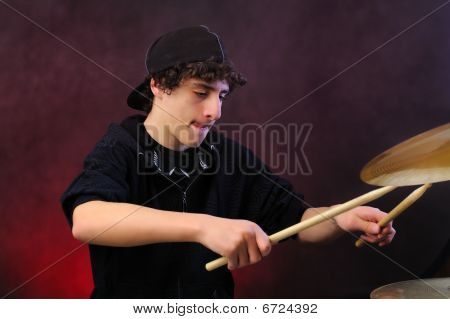 Teenage boy plays drums