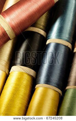 bobbins of colorful silk thread