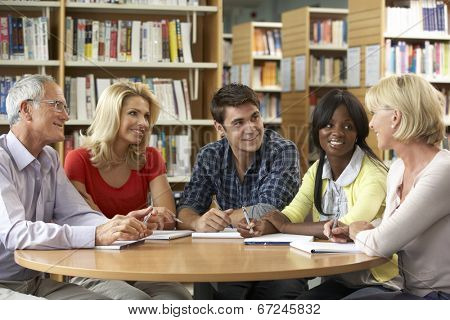 Mixed group of students in library
