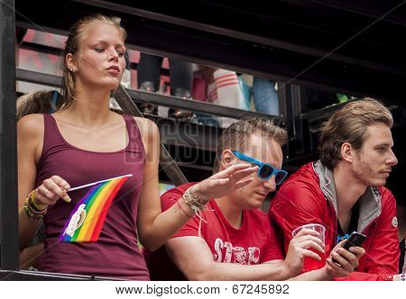 Unidentified Woman With Rainbow Flag.