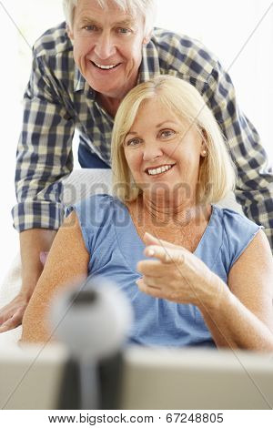 Senior couple using skype