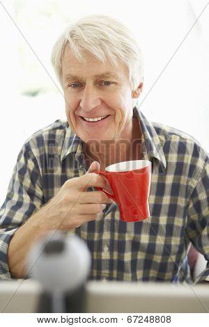 Mid age man using skype