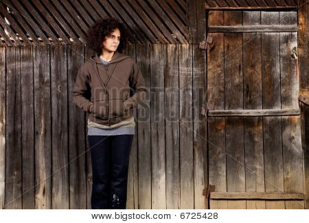Woman Standing Near Wooden Wall