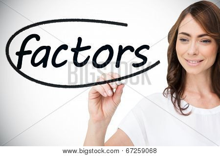 Businesswoman writing the word factors against white background with vignette