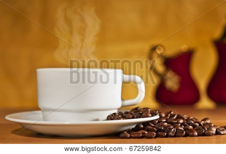 White Cup Of Coffee On A Yellow Background