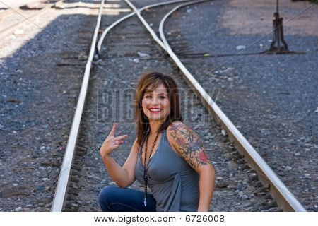 Woman On Track Giving Peace Sign