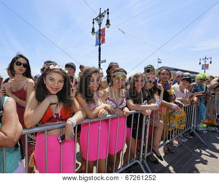Young female spectators in pink aquatic costumes