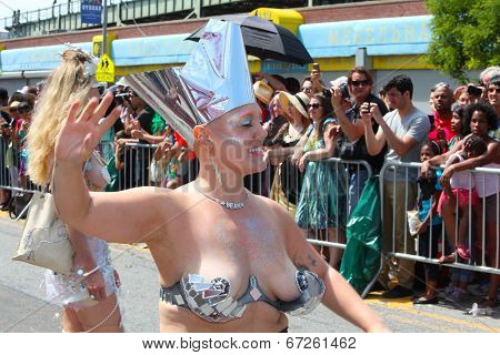 Woman with metal crown & brassiere