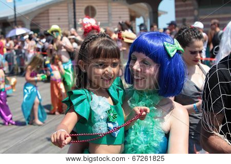 Mother & daughter in aquatic costume